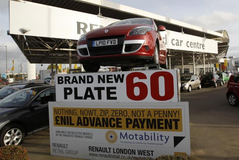 New cars are displayed for sale on the forecourt of a car showroom, in London November 4, 2010.