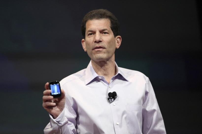 Jon Rubinstein, senior vice president and general manager for Palm, holds the HP Veer phone during a media presentation in San Francisco.
