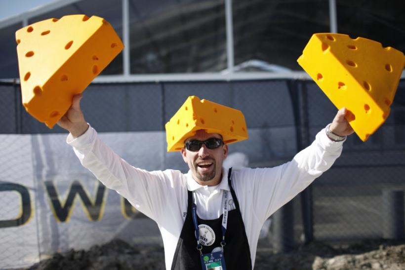 A vendor holds up Green Bay Packers cheese hats for sale outside Cowboys Stadium before the start of the NFL's Super Bowl XLV football game in Arlington.