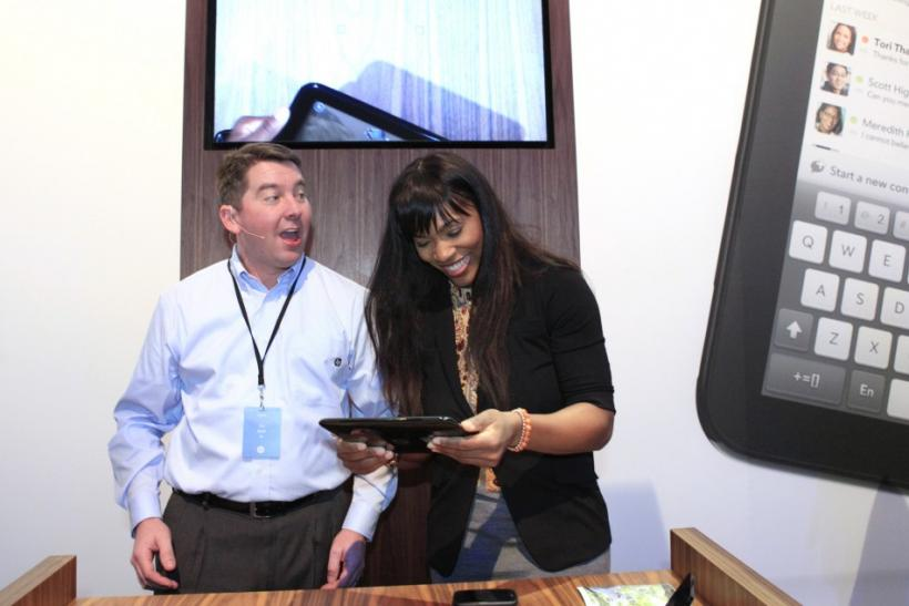 Pettitt gives pointers to Williams as she helps demonstrate the TouchPad after a media presentation at the Herbst Pavilion at the Fort Mason Center in San Francisco