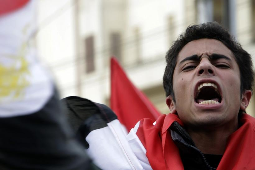An anti-government protester shouts anti-Mubarak slogans front of the Presidential palace in Cairo