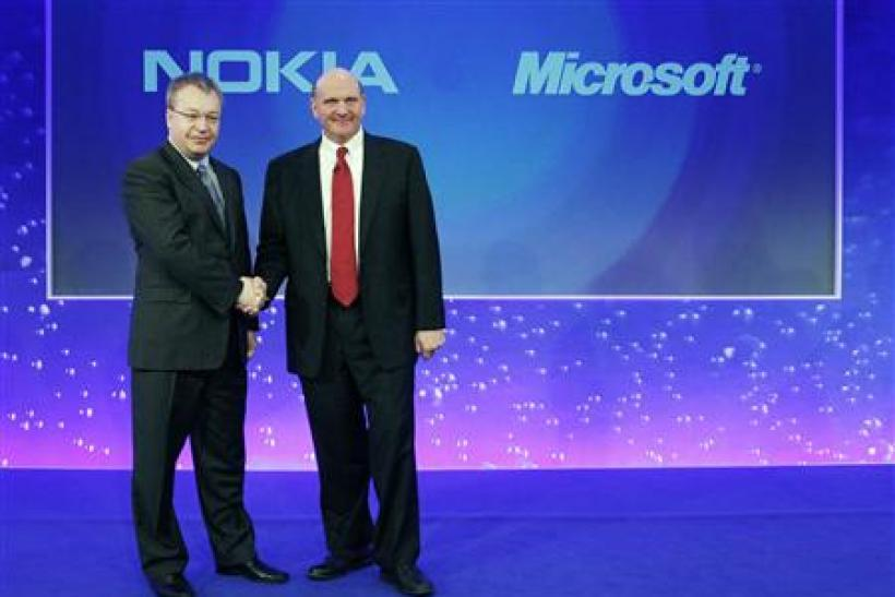 Nokia chief executive Stephen Elop welcomes Microsoft chief executive Steve Ballmer with a handshake at a Nokia event in London