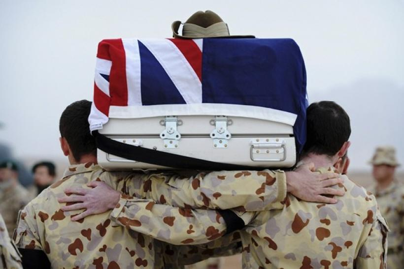 Australian Defence Force engineers carry the casket of a fallen colleague