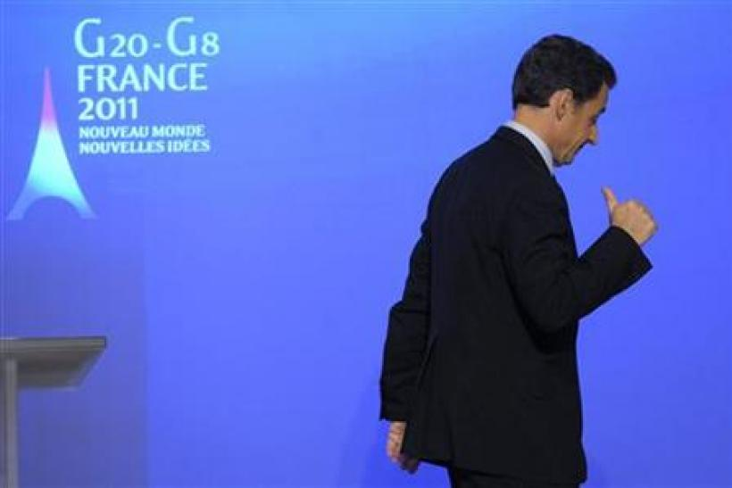 France's President Sarkozy leaves a G20 and G8 news conference at the Elysee Palace in Paris