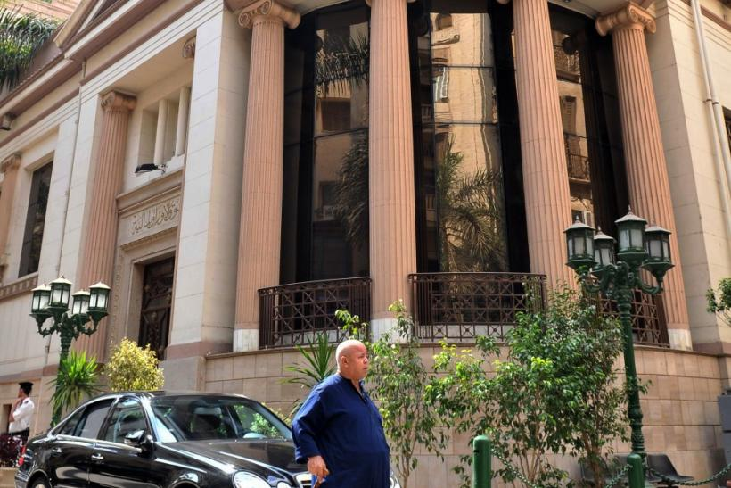 A man walks outside the Egyptian Stock Exchange in Cairo