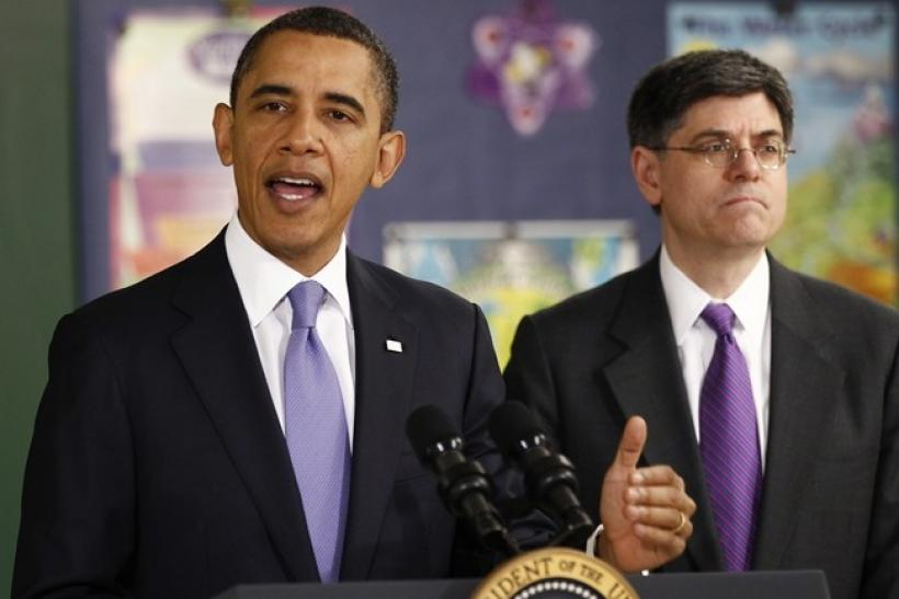 U.S. President Barack Obama speaks about the budget during his visit to Parkville Middle School and Center of Technology in Parkville, Maryland February 14, 2011. At right is OMB Director Jack Lew.