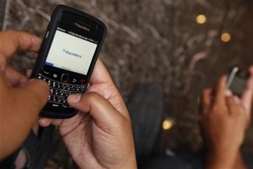A person surfs the internet through a Blackberry in Jakarta.