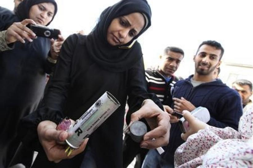 A Bahrain woman shows empty packages