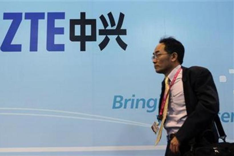 A man walks past a ZTE banner at the Mobile World Congress in Barcelona