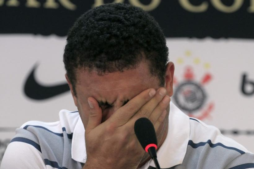 Ronaldo is overwhelmed with emotion while announcing his retirement from football at a press conference in Sao Paulo.