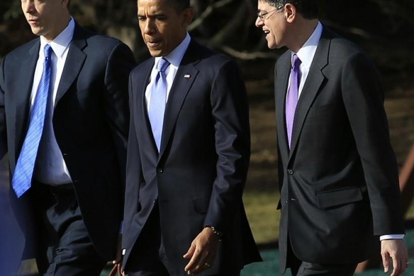U.S. President Barack Obama (C) walks across the South Lawn at the White House with OMB Director Jack Lew (R) and Secretary of Education Arne Duncan in Washington, February 14, 2011.