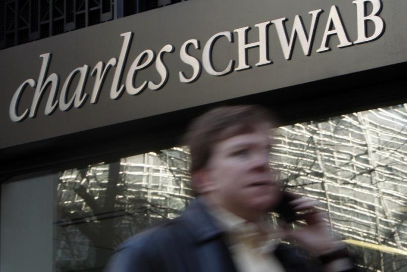 A man walks past a Charles Schwab Investment branch in Washington
