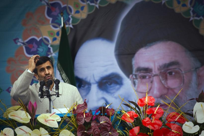Iranian President Mahmoud Ahmadinejad takes part in a rally to mark the 32nd anniversary of the Islamic Revolution in Tehran February 11, 2011.