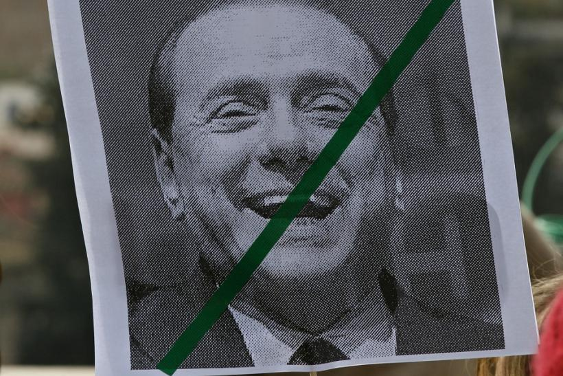 "A placard reading ""Berlusconi unworthy"" is displayed during a demonstration against Italy's Prime Minister Silvio Berlusconi in downtown"