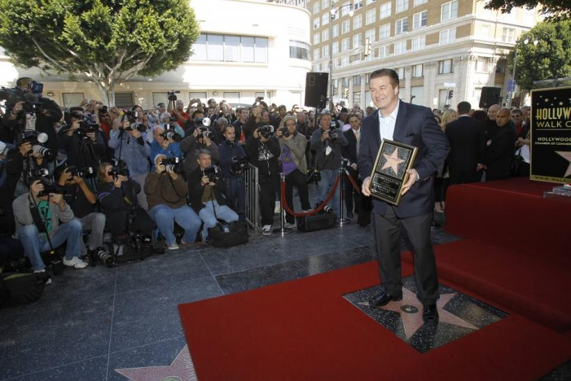 Baldwin stands on his star on the Walk of Fame in Hollywood.