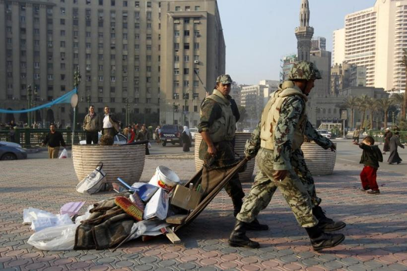 Army soldiers remove makeshift shelters and clear Tahrir Square in Cairo