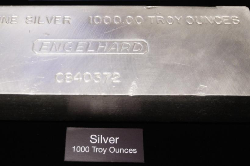 A 999 + Fine Silver 1000 Troy Ounce Engelhard Silver Bar is placed on the floor of the New York Stock Exchange November 9, 2010.