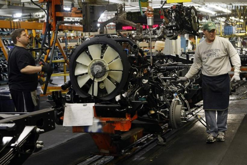 General Motors auto assembly workers lower an engine onto the chassis for Chevrolet Silverados and GMC Sierra pickup trucks at the Flint Assembly in Flint, Michigan