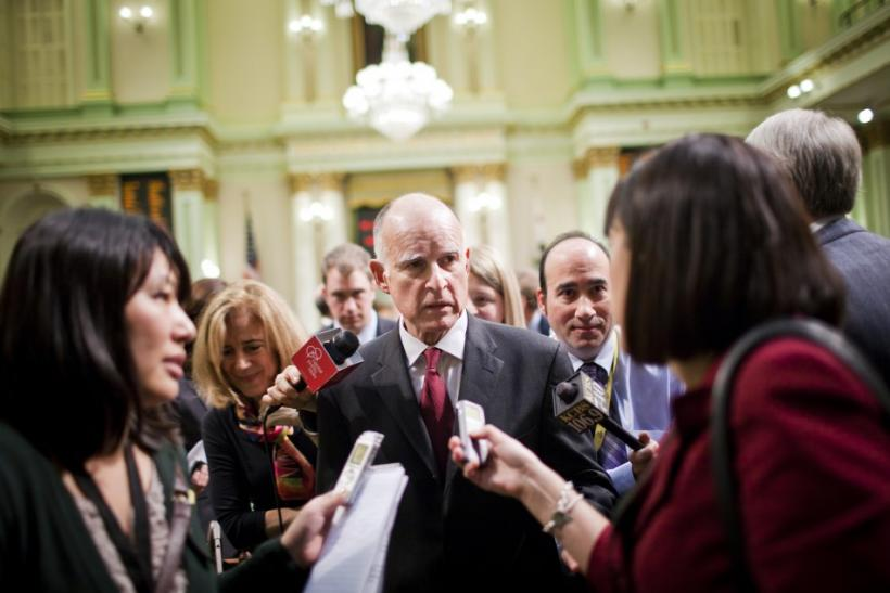 California Governor Jerry Brown speaks to reporters after delivering the State of the State address in Sacramento