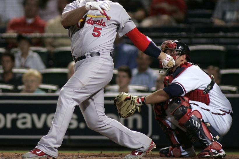 Cardinals slugger Albert Pujols hits a solo home run against the Braves during their National League MLB baseball game in Atlanta.