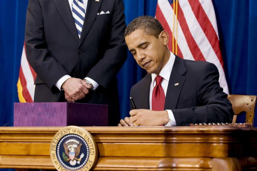 U.S. President Barack Obama signs stimulus package bill at the Denver Museum of Nature and Science