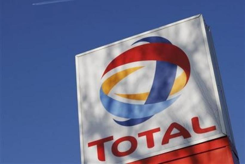 A logo for French oil giant Total SA is seen at a petrol station in London