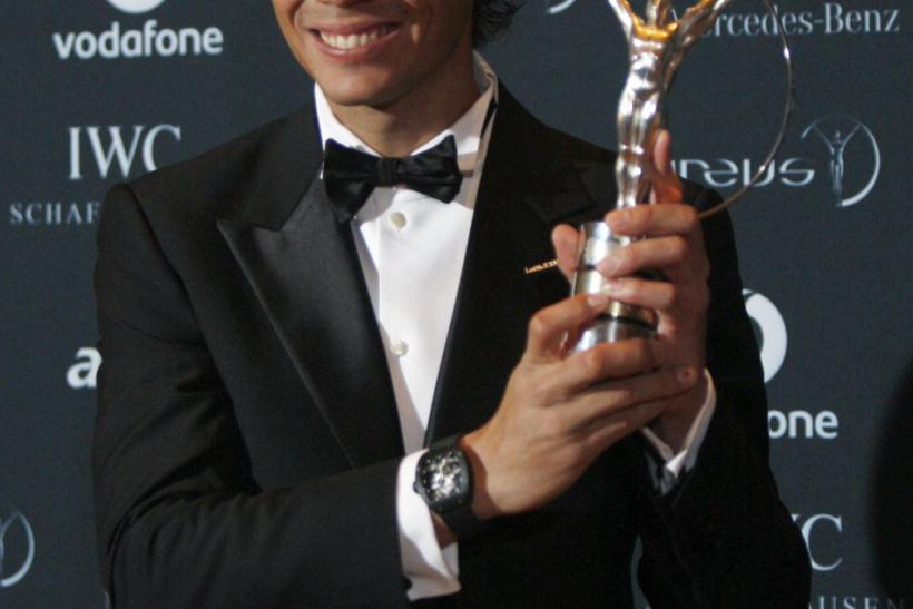 Tennis champion Nadal poses with his Laureus World Sportsman of the Year Award at Emirates Palace in Abu Dhabi.