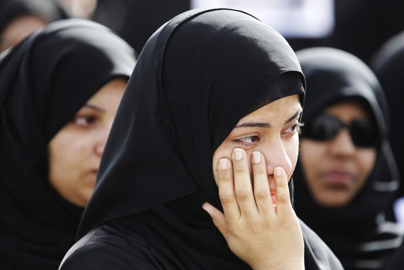 A relative of a protester, who was killed in Thursday's crackdown, mourns during a funeral procession in Sitra, east of Manama
