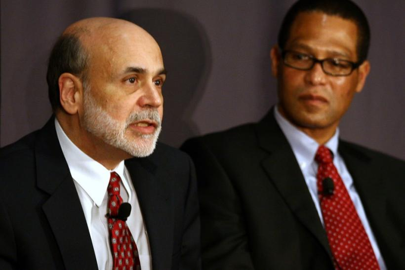 Fed Reserve Chairman Bernanke speaks as CEO of Sophisticated Systems Smith looks on during a discussion at The Ohio State University