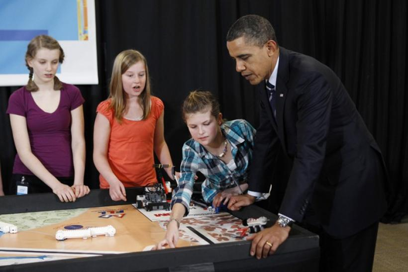 U.S. President Barack Obama watches a Lego robot as he meets student finalists of Intel's Science Talent Search in Hillsboro