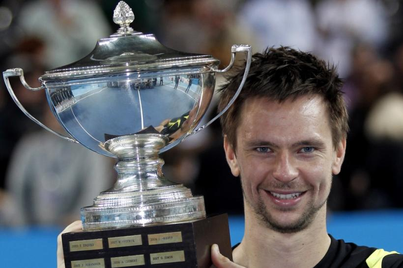 Soderling of Sweden holds his trophy after winning against Cilic of Croatia at their men's final match at the Marseille Open tennis tournament.