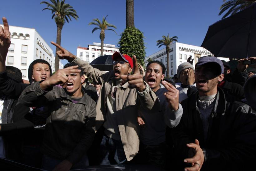 People chant slogans during a protest in Rabat
