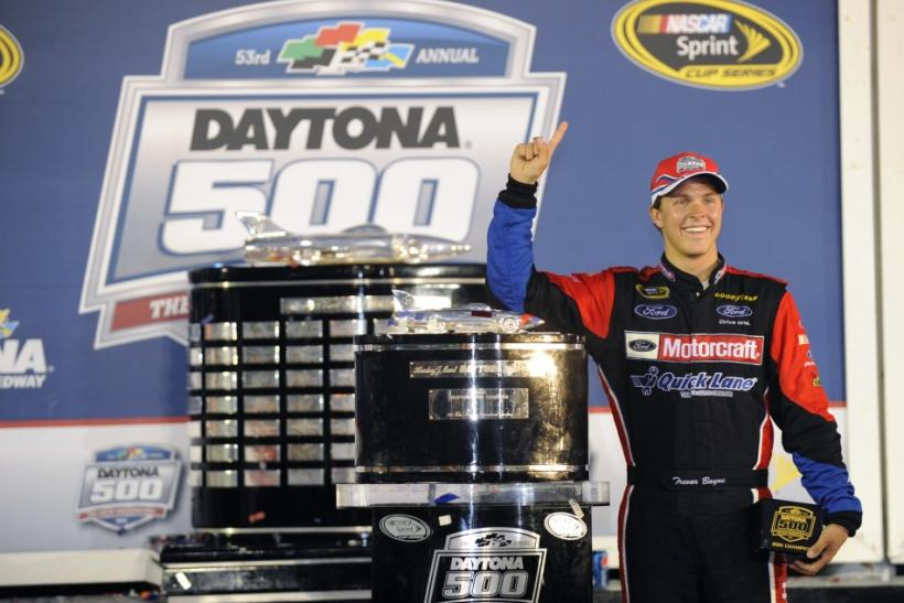 Sprint Cup Series driver Bayne stands next to the trophy in victory lane after winning the NASCAR Sprint Cup Series Daytona 500 race.