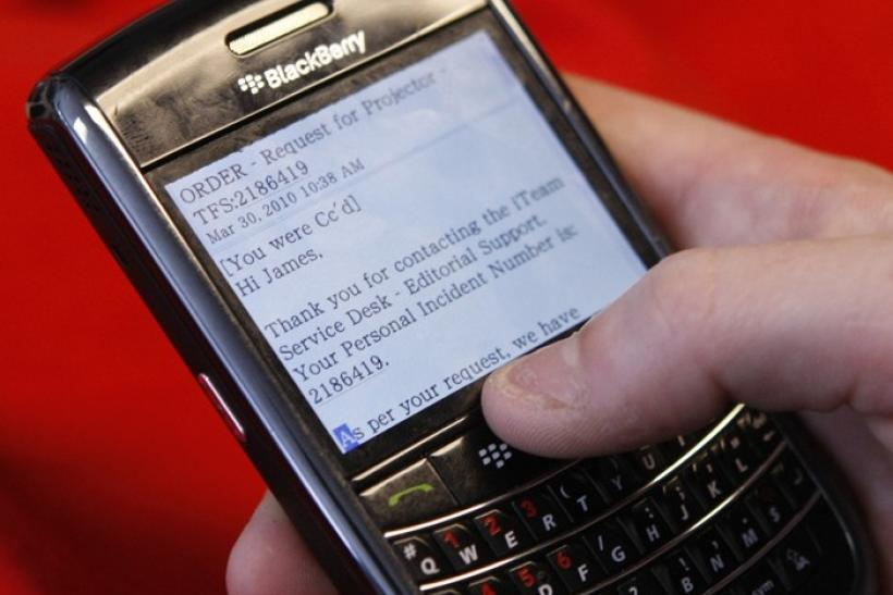 A BlackBerry smartphone user is pictured checking email in Washington