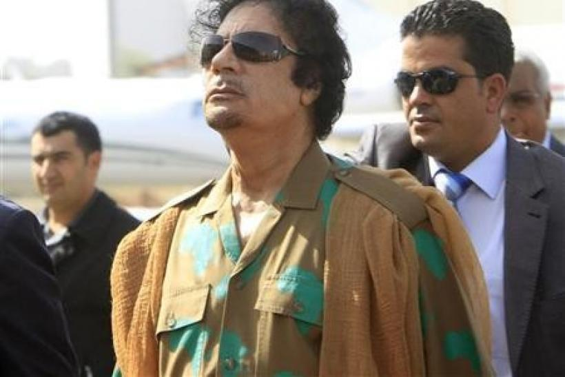 Libyan leader Muammar Gaddafi arrives at Khartoum airport, Sudan,