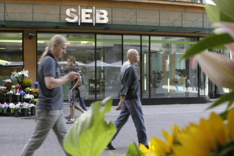 People walk past a SEB bank branch in Riga