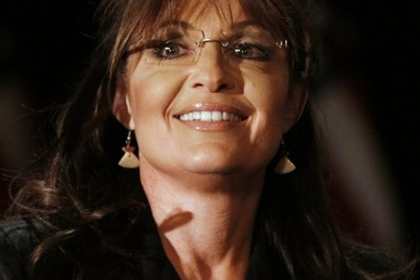 Former Alaska governor Sarah Palin sits before speaking to the LIA (Long Island Association) Annual Meeting & Luncheon at the Crest Hollow Country Club in Woodbury, New York February 17, 2011.