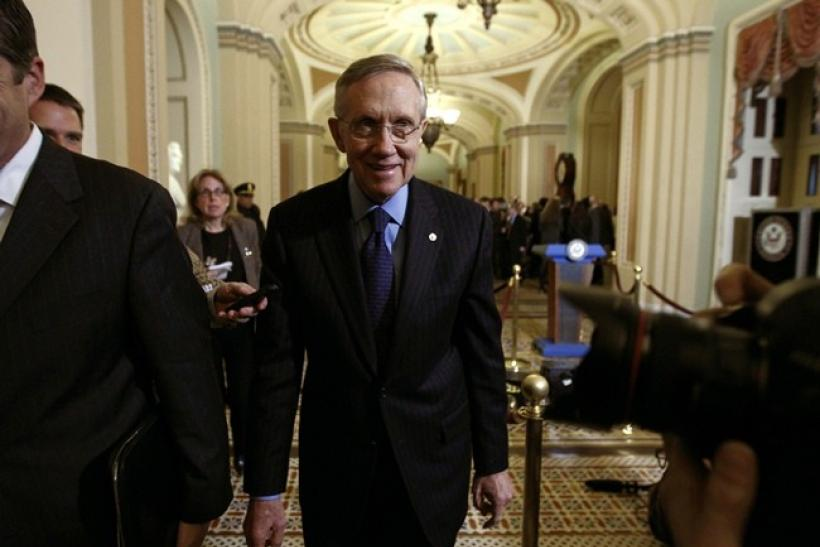 Senate Majority Leader Harry Reid smiles as he makes his way from the Old Senate Chamber after a closed session about the new START treaty on Capitol Hill in Washington December 20, 2010.