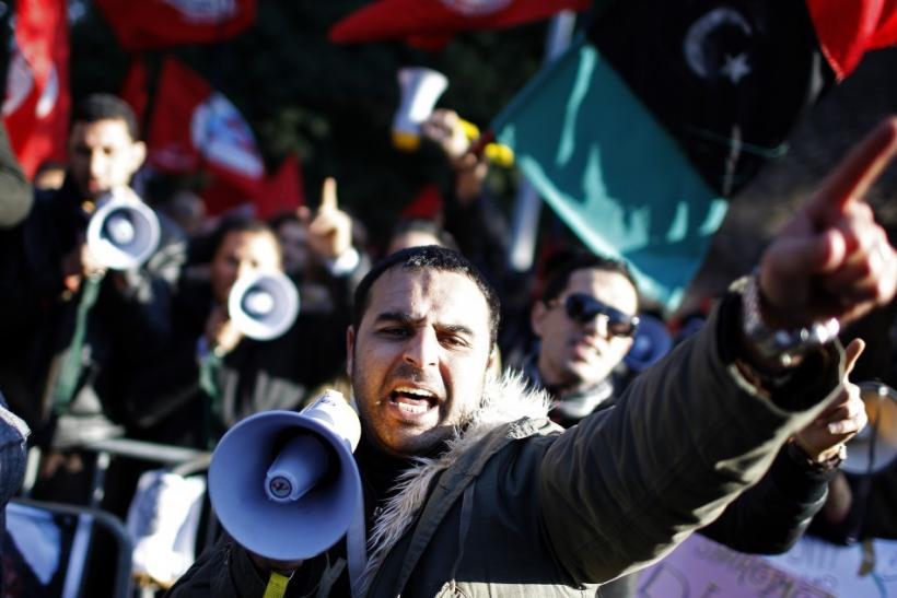 A protester shouts slogans during a demonstration against Libyan leader Muammar Gaddafi in front of Libya's embassy in Rome