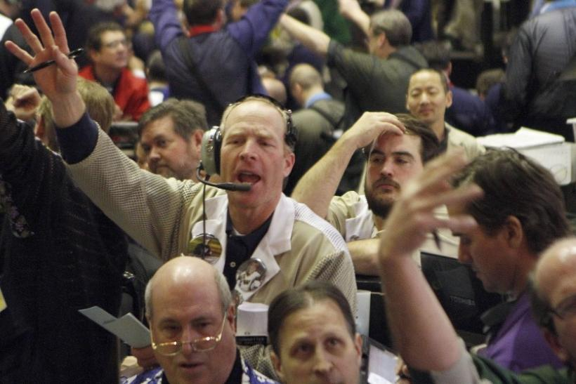 Traders in the Corn options pit at the CME Group signal orders shortly before the closing bell in Chicago