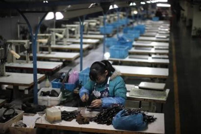 A laborer works at an empty shoe factory in the city of Wenzhou, in Zhejiang province February 18, 2011.