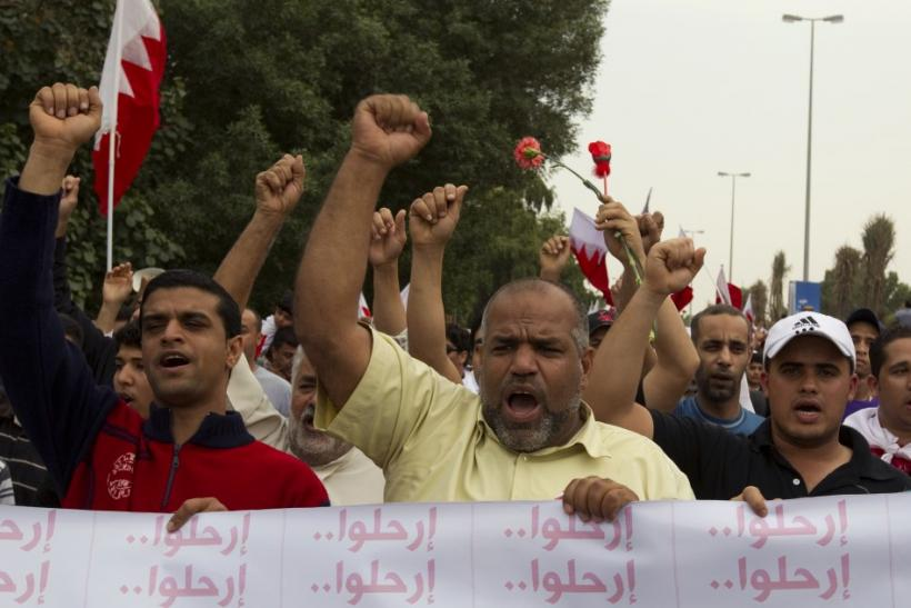 Protesters shout slogans during a demonstration in Manama