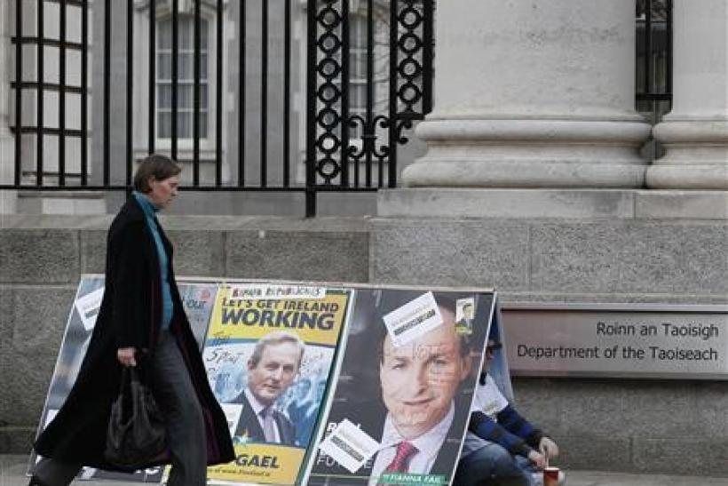 A man protests outside the Department of the Taoiseach in Dublin