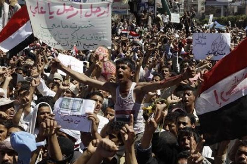 Protesters take part in an anti-government rally outside Sanaa University