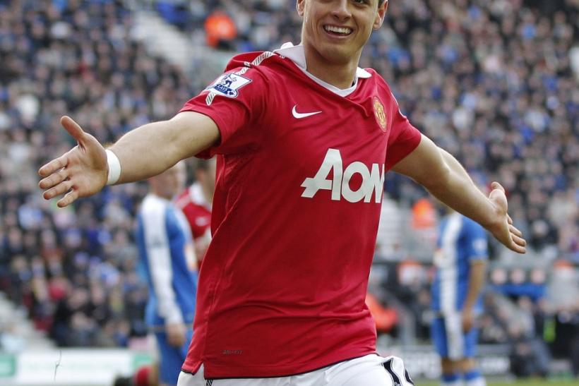 Manchester United's Hernandez celebrates after scoring during their English Premier League soccer match against Wigan Athletic at the DW Stadium in Wigan.