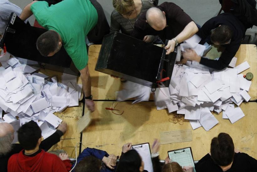 Ballot boxes are emptied during an election count in Dublin