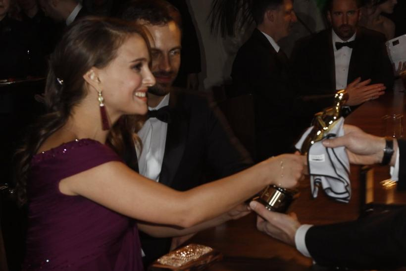 "Actress Natalie Portman holds her Oscar she won for best actress for her role in ""Black Swan"" after the name plate was engraved at Governor's Ball in Hollywood"
