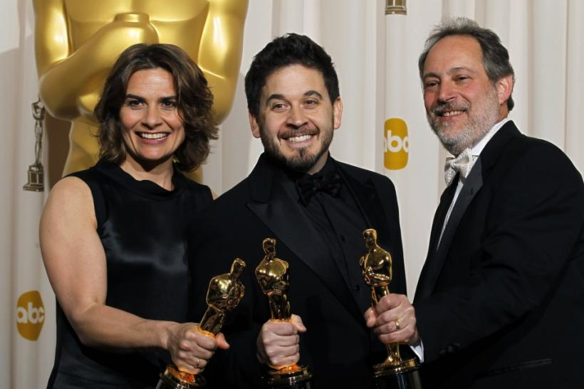 Oscar winners for music (sound mixing) for the film 'Inception,' Lora Hirschberg, Gary A. Rizzo (C), and Ed Novick, pose backstage at the 83rd Academy Awards in Hollywood, California.