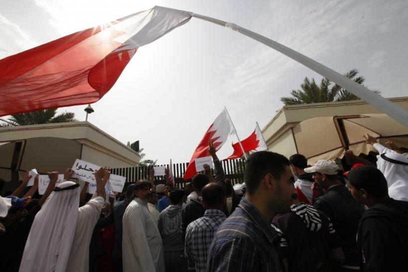 Bahraini Shi'ite men shout anti-government slogans as they protests outside the parliament in Bahraini capital of Manama, February 28, 2011.