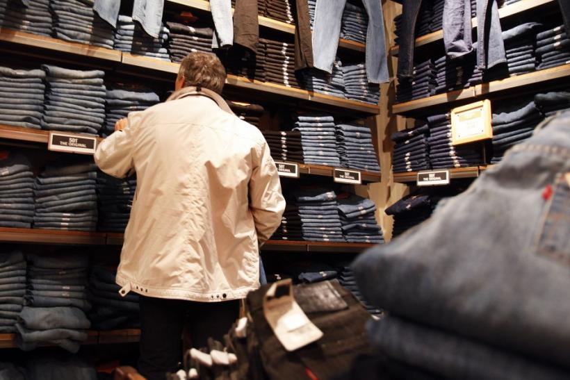 A man shops for blue jeans at a clothing store in New York